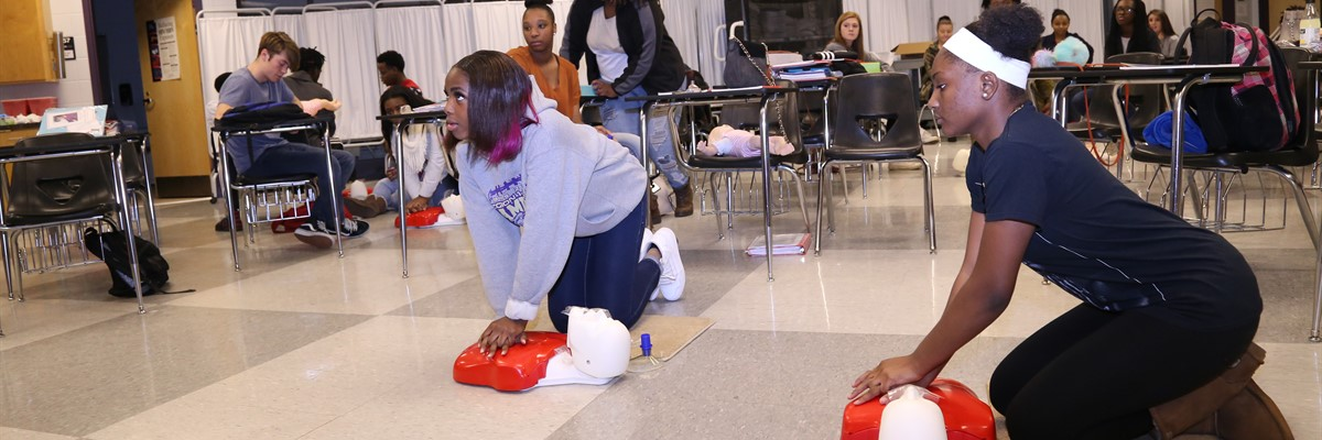 CPR Practice with Mrs. Bland in Healthcare Science